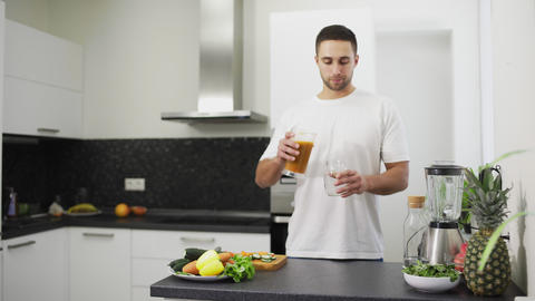 Man is pouring fresh juice into a jar Stock Video Footage