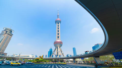 Shanghai Oriental pearl TV tower building in Shanghai Downtown skyline, China. Financial district Live Action
