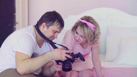Model and photographer watching photos together Footage