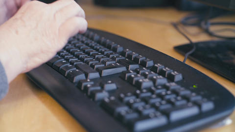 Hands of old woman typing on a computer keyboard Footage