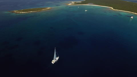 Aerial - High angle view of a sailboat arriving to the destination Live Action