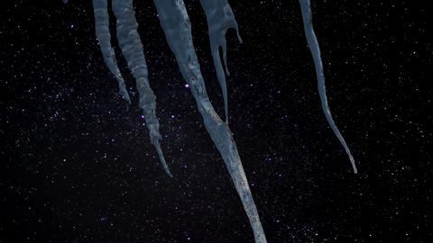 Timelapse - Icicles with a starry night in the background Live Action