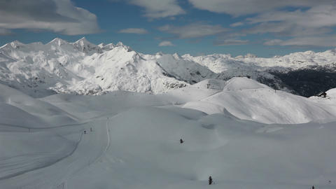 Timelapse - Panoramic view of people skiing in idyllic mountains Footage