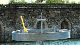 Old christian church under water with metal candlestick on the shore and cross o Footage