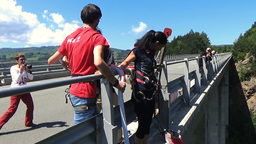 Klisura Bridge, Bulgaria - June 11, 2016: Bungee jumper girl getting ready for 2 Footage