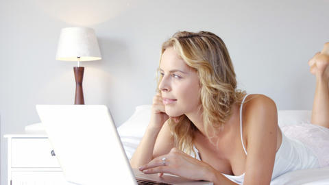 Woman is using a laptop Live Action
