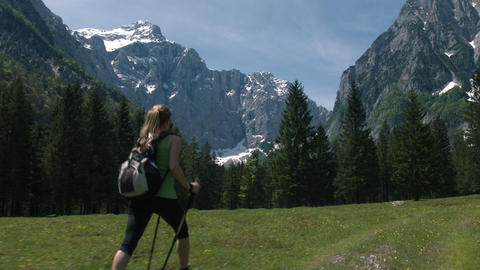 Young woman hiking alone in the mountains, full shot Footage