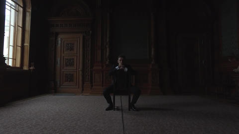 Thoughtful Man Sitting On Chair Footage