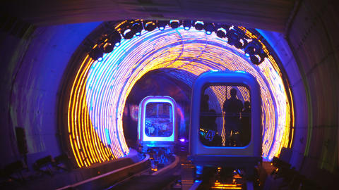 Shuttle trains in Bund Sightseeing Tunnel. Metro subway train in Shanghai City, China. Tunnel of Live Action