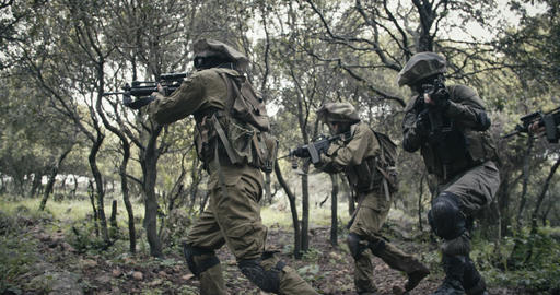 Squad of fully armed commando soldiers during combat in a... Stock Video Footage