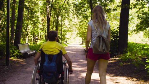 Disable man and his wife on a walk Live Action