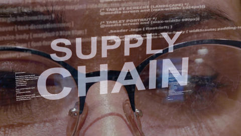 Supply Chain text on background of female developer Footage