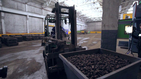 worker transports container of ore with forklift loader Footage