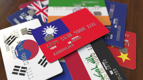 Many credit cards with different flags, emphasized bank card with flag of Taiwan Live Action
