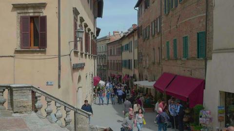 [alt video] People walking in a main street of Montepulciano, in...