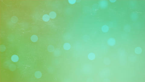Abstract bokeh particles on green background. Abstract motion background Animation
