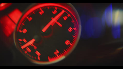 speedometer with jumping arrow on dashboard close view Live Action