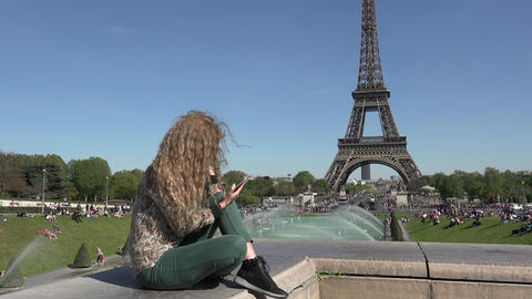 Paris, circa MAY 2016:Attractive Woman play with her devices In Paris At Eiffel Footage