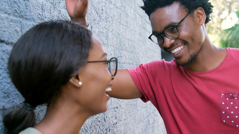 Young hipster is charming an attractive girl Footage