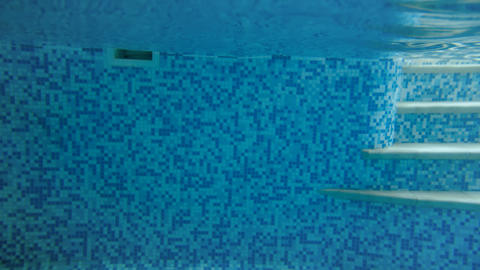 4k video of teenage girl diving under water in swimming pool. View from under Live Action