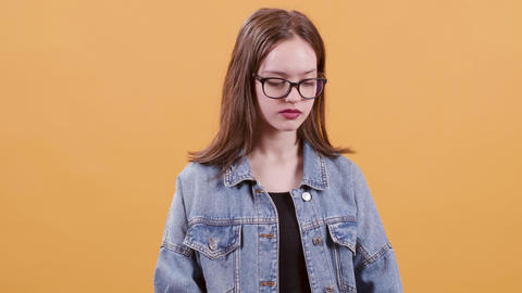 Very cute teenage girl looking serious and confident at the camera Footage