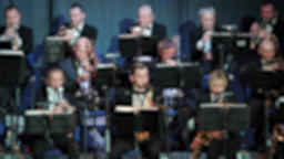 Brass orchestra is playing music. Defocused Footage