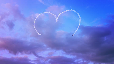 Two planes drawing a heart in the sky with smoke Animation