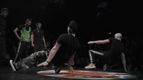 Cute active men guys sporty outfits perform cool breakdancing on stage Live Action