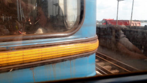 4k closeup footage of dirty and rusty metro car riding on long bridge over river Footage