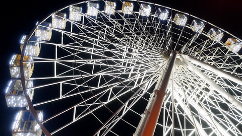 4k video of illuminated big ferris wheel in amusement park at night Footage
