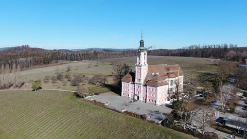 Beautiful aerial footage of a catholic church with beautiful background, 4k Live Action