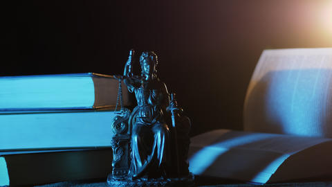 The Statue of Justice - Statuette, light and books Footage