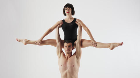 Acrobatic choreographic trick couples on a white background Footage