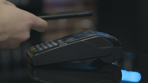 Close-up shot of person using NFC technology on smart phone to pay Footage