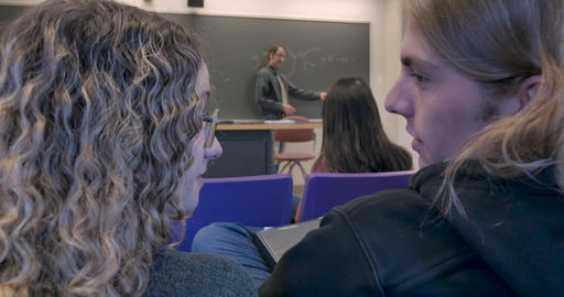 Male science professor tells two students talking to be quiet during his chemistry class Footage