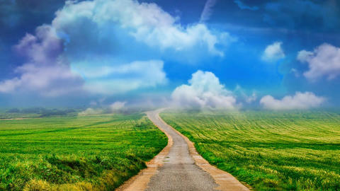 04 landscape of road in fields and moving clouds on a blue sky Animation