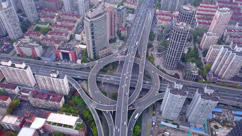 Aerial view of highway junctions with roundabout. Bridge roads shape circle in structure of Footage