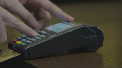 Credit card machine chip and pin code being entered by a man POV. A detail Live Action