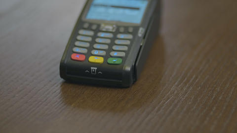 Closeup shot of customer pay over the wireless tradings card-reader. Adult human Footage