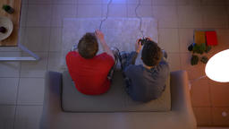 Top shot of two friends in pajamas playing videogame together using joystick Footage