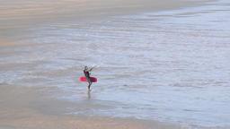 Kitesurfer Running on Coastal Sands Footage