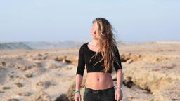 Young Caucasian Woman Modeling in Desert Footage