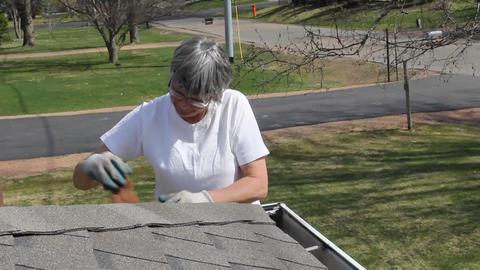 Woman worker cleaning house rain gutters Footage
