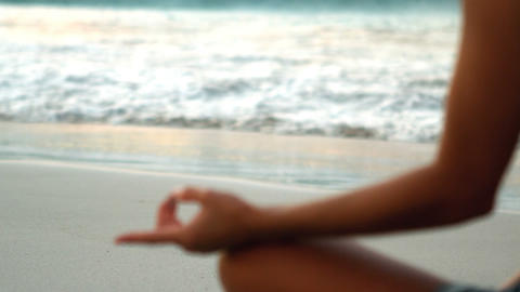 Woman performing yoga on beach Live Action