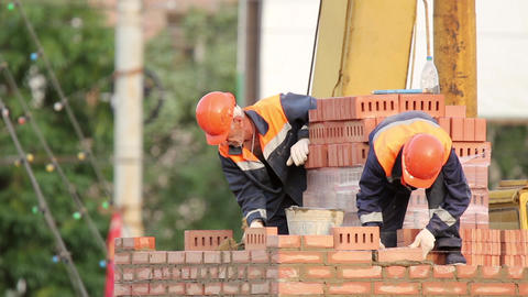 Two bricklayer building a brick wall Footage