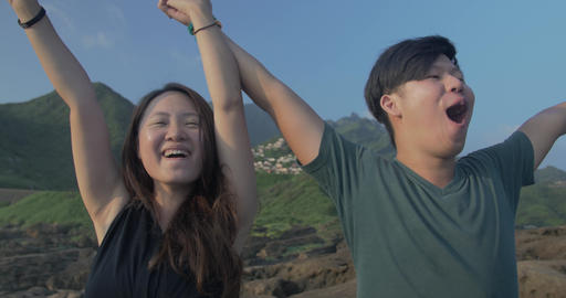 Taiwanese couple screaming to ocean mountain background beautiful location- 2 Filmmaterial