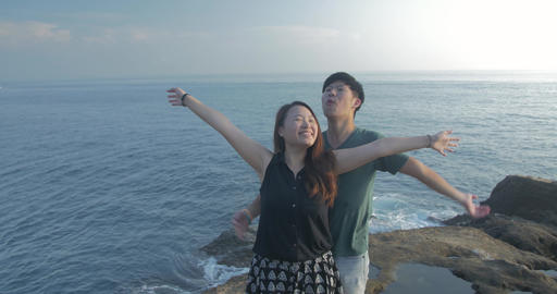 Young Couple dancing on beautiful rocks location on sea cost line of taiwan 3 ビデオ