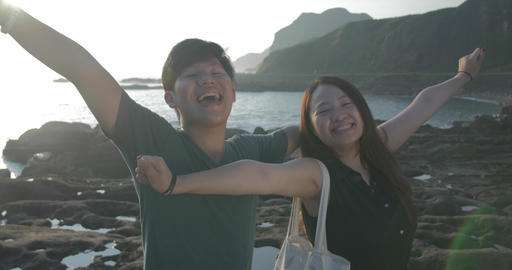 Young Taiwanese couple celebrating in beautiful seas coast location taiwan 1 ビデオ