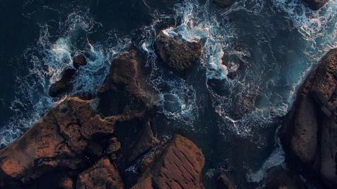 Beautiful View of rock pools on coastline in Taiwan waves crashing Aerial Shot Footage
