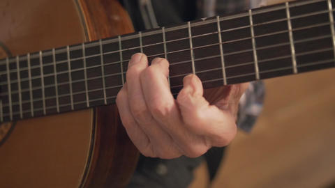 Old Retired Senior Man Hands Playing Guitar Closeup Footage